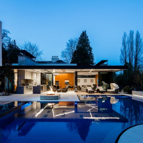 Night time show of the large pool with seamless outdoor living