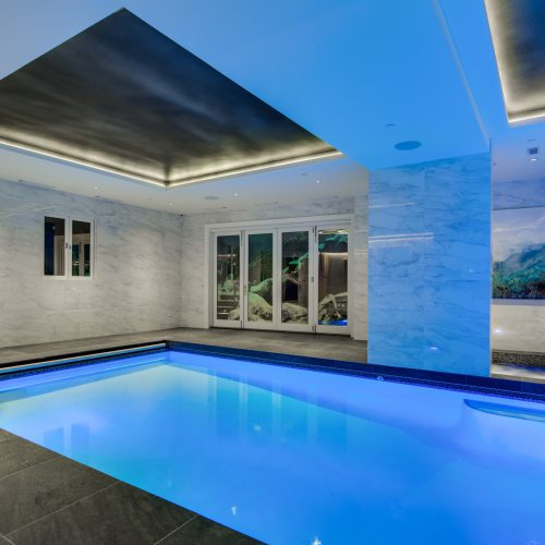 Modern indoor swimming pool with color lighting